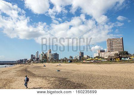 Cloudy Blue Sky At  Beachfront Against  City Skyline