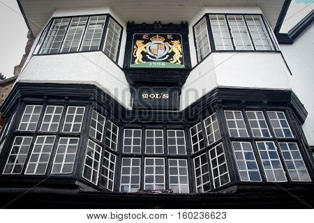 EXETER UK 11 July 2016: Facade of an ancient building in the center of Exeter. Mol`s House 1596. The coat of arms of the city. Devon. England