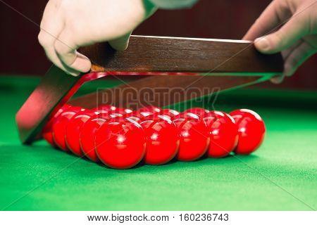 Racking up snooker balls, toned image, horizontal