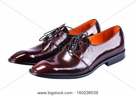 Men's classic leather shoes designed with a slim elongated toe made from a smooth brown leather. Isolated on a white background.