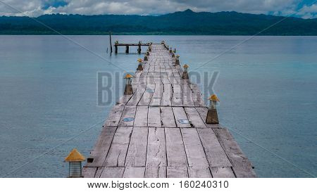 Pier of Dive Station on Kri Island. Clound above Gam Island in Background. Raja Ampat, Indonesia, West Papua.