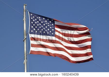 Flag of the United States of America flying high.