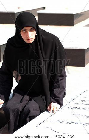 TYRE,LEBANON-OCTOBER 23: An unidentified Lebanese woman is praying near the grave of her family who died in Israel bombardment in Qana on October 23, 2006 ,in Tyre, Lebanon.