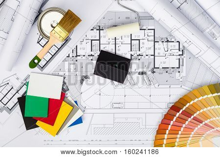 Construction Plans With Whitewashing Tools,colors Palette And Miniature House On Blueprints