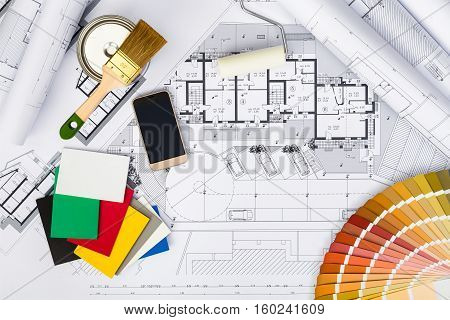 Construction Plans With Whitewashing Tools,colors Palette And Smart Phone
