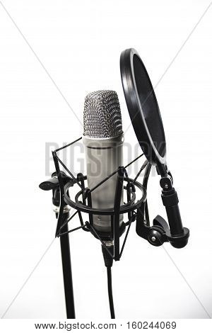 Microphone with mesh. Studio microphone on a white background