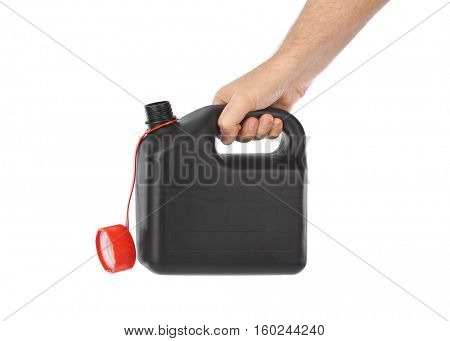 Hand with plastic jerrycan isolated on white background