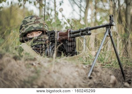 Soldier Aiming From Machine Gun