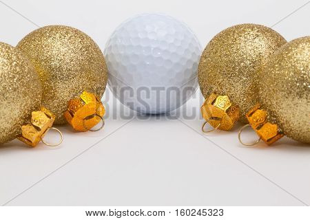 Golf ball and Christmas decoration on the white table