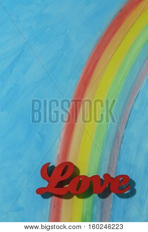 The word love with a background rainbow illustrating the concept of love lust desire and joy; portrait format