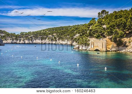 Abrupt stony coast and turquoise sea surface. Famous National Park Calanques on the Mediterranean coast. Provence, France, spring