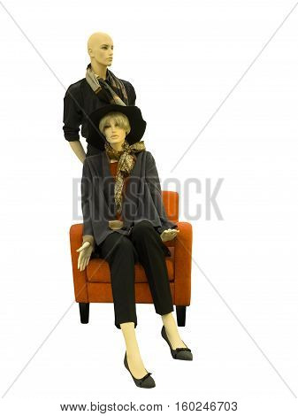 Two mannequins male and female dressed in fashionable clothes isolated on white background. No brand names or copyright objects.