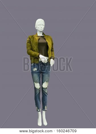 Full-length female mannequin wearing jacket pullover and destroyed jeans isolated. No brand names or copyright objects.