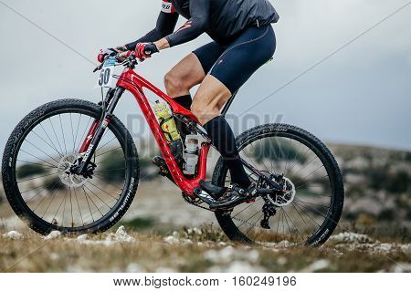 Privetnoye Russia - September 21 2016: closeup of athlete mountainbiker and sport bicycle racing in water bottle during Crimean race mountainbike
