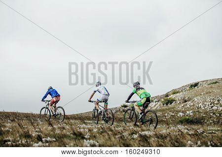 Privetnoye Russia - September 21 2016: group athletes cyclists ride mountainbike mountain landscape during Crimean race mountainbike