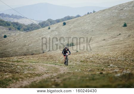 Privetnoye Russia - September 21 2016: athlete a cyclist riding on mountainbike in a mountain valley during Crimean race mountainbike