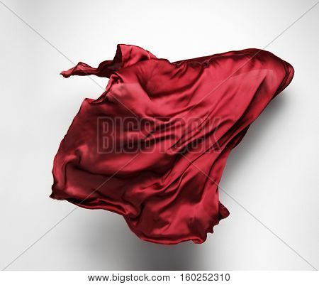 piece of red fabric soaring, art object, design element