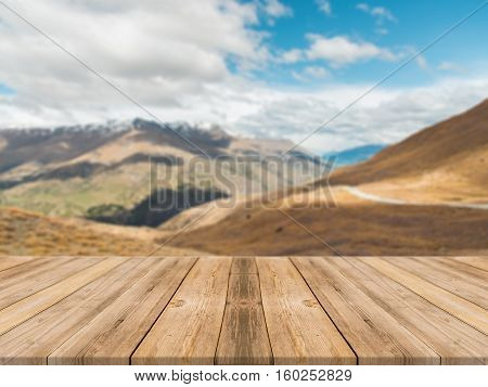 Wooden board empty table in front of blurred background. Perspective brown wood table over blur mountain landscape background - can be used mock up for display or montage your products.