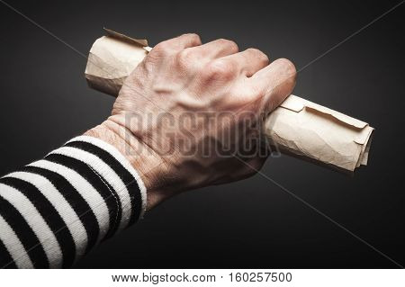 Sailor Hand Holds Rolled Old Paper