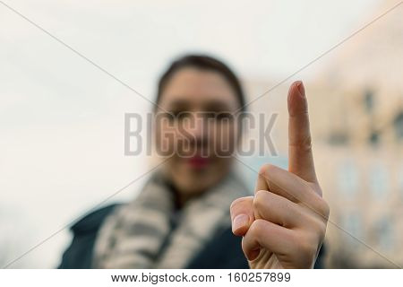 Angry Woman Warning You. Blurred  Woman Wagging Her Finger