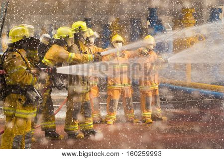 Fireman Showing How To Use A Fire Sprinklers. On A Training Fire