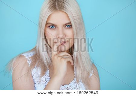 Portrait of young beautiful girl with long straight dyed hair and clean make-up