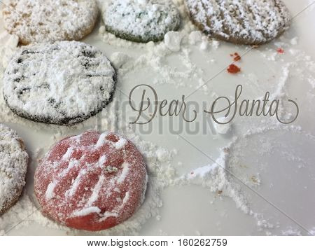 Christmas home made shortbread cookies on a plate with powdered sugar like snow and crumbs half eaten and words written