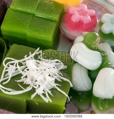 The group of Thai sweet dessert : Layer sweet cake (Kanom Chan), Green coconut sweet pudding (Kanom Piak Poon), Coconut milk jelly (Wun Kati).