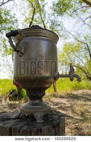 Old russian tea samovar on the stump