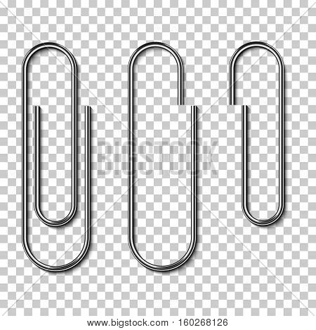 Metal paperclips isolated and attached to paper