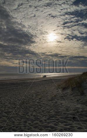 A 4 wheel vehicle travels along the beach in Emeralde Isle North Carolina