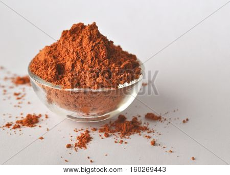 Red clay powder Montmorillonite in bowl isolated with copy space