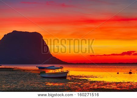 Fishing boat at sunset time. Le Morn Brabant on background. Mauritius.