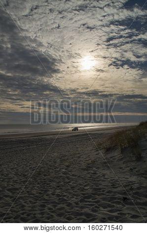A 4 wheel drive vehicle travels along the beach in Emeralde Isle North Carolina