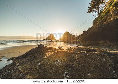 Sun setting between two sea stacks on the Oregon coast.