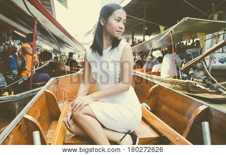 Thai woman at the floating market. Travel concept