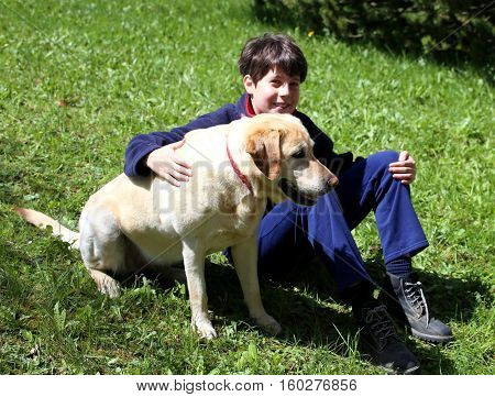 Cute Little Boy With His Dog