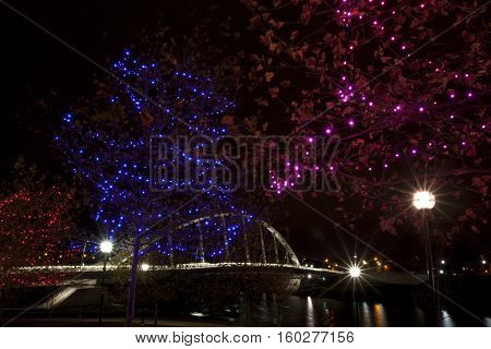 The Main Street Bridge glows behind the Christmas illumination along the Scioto Mile in Columbus, Ohio.