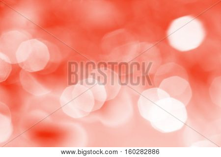 Abstract red background with white spots and patches of light