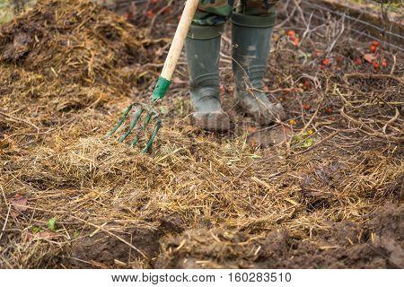 Man Working In Garden With Fork