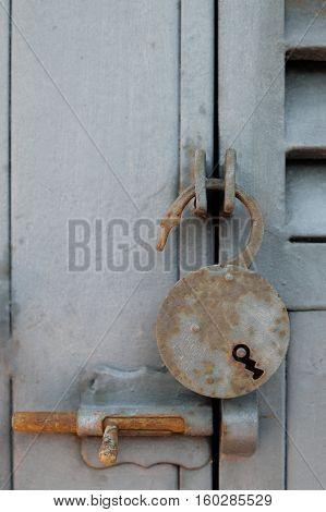 Open Rusty Padlock On Metal Door
