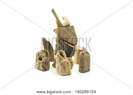 Pieces of drift wood stacked up to look like an deer or reindeer?with surrounding, pieces of drift wood. Isolated on white