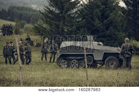 PERM RUSSIA - JULY 30 2016: Historical reenactment of World War II summer 1942. German soldier and armored car.