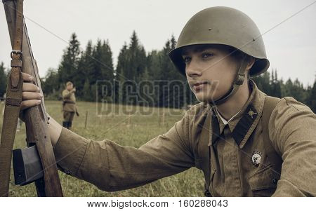 PERM RUSSIA - JULY 30 2016: Historical reenactment of World War II summer 1942. Soviet soldier with rifle