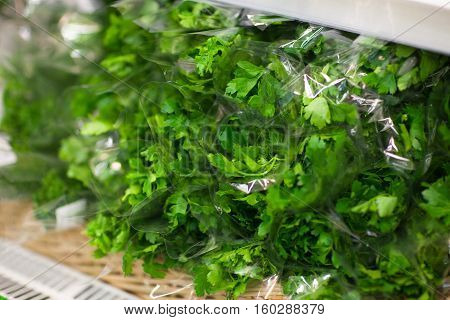 Supermarket shelf, Fresh organic herbs, parsley, dill. Fresh organic on shelf in supermarket. Healthy food concept. Vitamins.