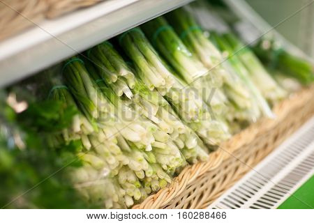 Supermarket shelf, Fresh organic herbs, Bundles of green onions. Fresh organic on shelf in supermarket. Healthy food concept. Vitamins.
