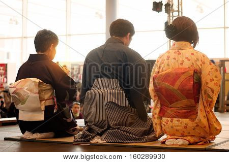 Guest at the tea ceremony from behind