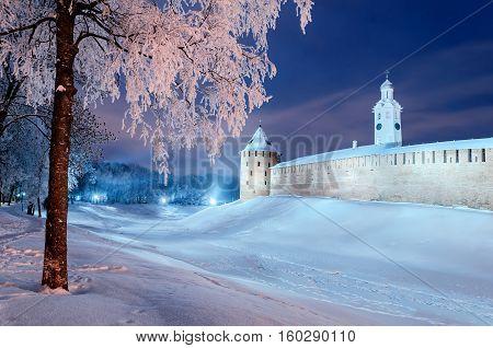 Winter landscape - Novgorod Kremlin in winter night in Veliky Novgorod Russia. Winter landscape night view of snowy city Veliky Novgorod - colorful night scene in cold weather