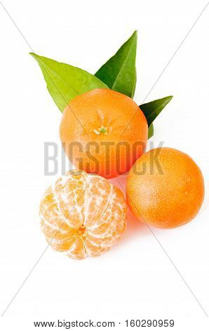 fresh orange fruits isolated on white. Top view peeled mandarin and mandarin with leaf