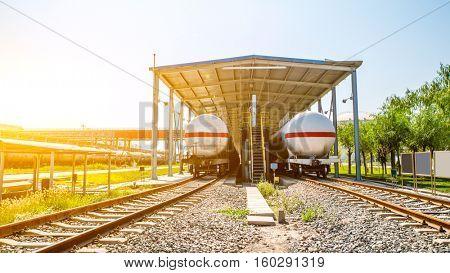 railroad with tank train at sunrise